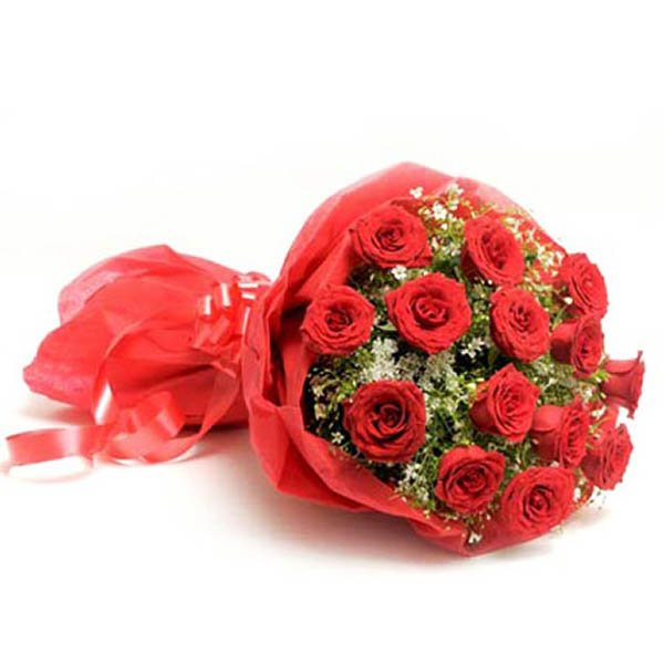 15 red roses with seasonal green leaves wrapped with red paper, and tied with red ribbon
