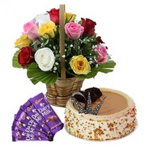 Round shaped butter scotch cake, and colourful roses basket with dairy milk chocolates