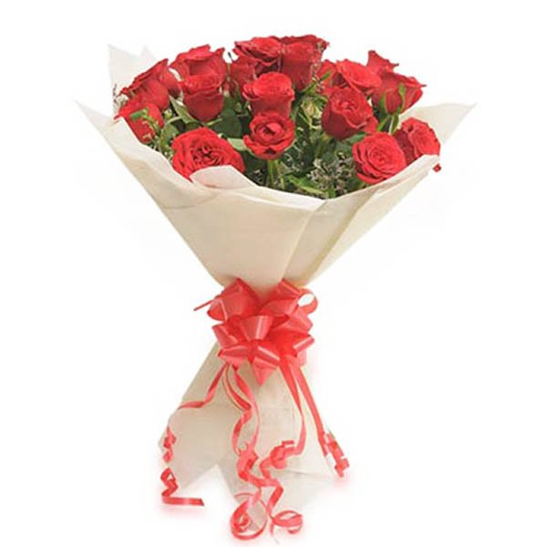 20 Red roses wrapped with off white paper and red ribbon