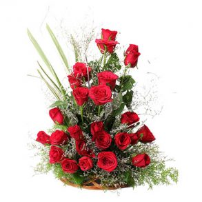 Basket of red roses and seasonal green leaves