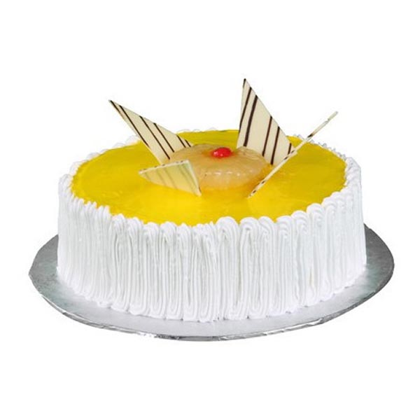 Designer round shaped pineapple cakes beautified with pineapple syrup