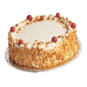 Designer round shaped butter scotch cake with red cherries on top