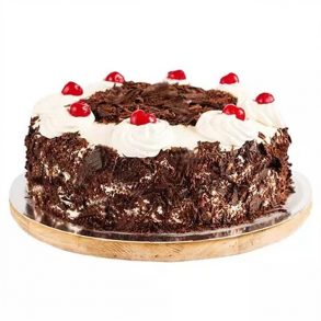 Round shaped black forest cake decorated with chocolate crust on side and white cream with cherries on top