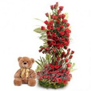 Big basket arrangement of red roses, and brown teddy bear