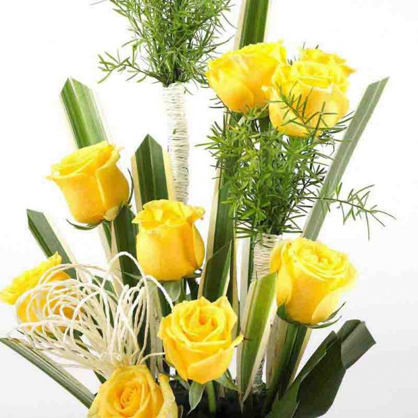 12 yellow roses decorated with green leaves
