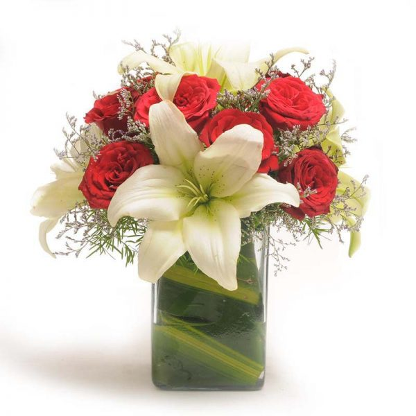 10 red roses and 5 white lilies in a square glass vase