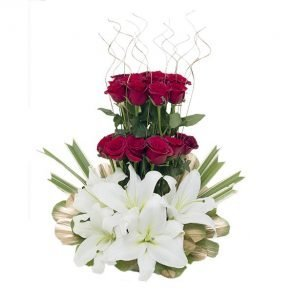 Basket arrangement of red roses and white lilies