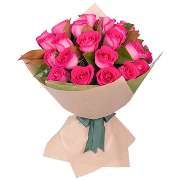 Pink roses wrapped in brown paper