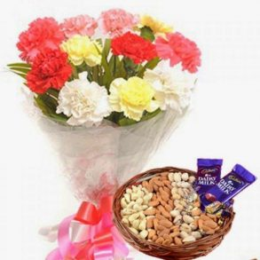 Colourful carnation bunch with dry fruit basket and diary milk chocolate