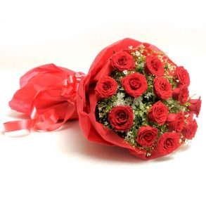 15 red roses with green leaves wrapped in red paper and tied with red ribbon