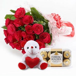 Red roses bunch with ferrero rocher chocolate with small white teddy