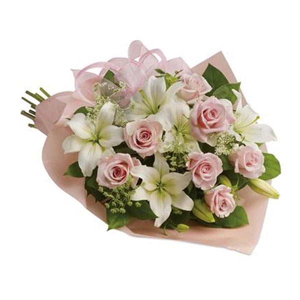 Light pink roses and white lilies wrapped in light pink paper