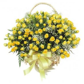 Big basket of yellow roses and seasonal green leaves beautified with yellow ribbon