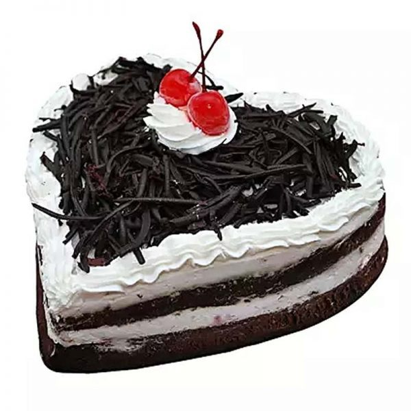 Heart shaped black forest cake decorated with black chocolate crust and cherries