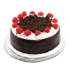 round shaped black forest cake with red cherries on top