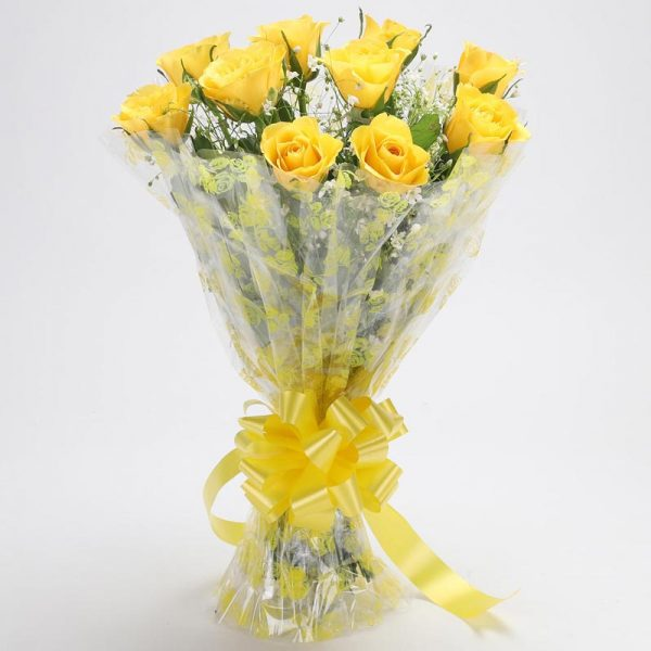 10 yellow roses with green leaves wrapped in cellophane and tied with yellow ribbon