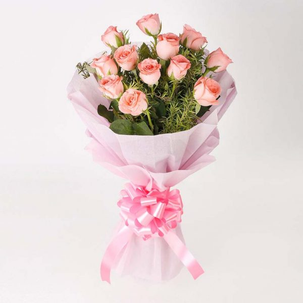 12 light pink roses with green leave wrapped in pink paper and tied with light pink