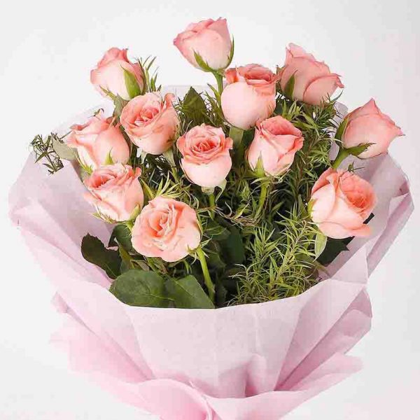 12 light pink roses with green leave wrapped in pink paper