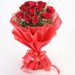 12 red roses wrapped in red paper and tied with red ribbon