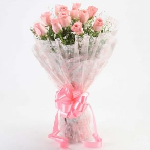 12 light pink roses with green leaves wrapped in cellophane and tied with ligh pink ribbon