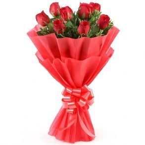 8 red roses with green leaves wrapped in red paper and tied with red ribbon