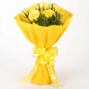 8 yellow roses with green leaves wrapped in yellow paper and tied with yellow ribbon