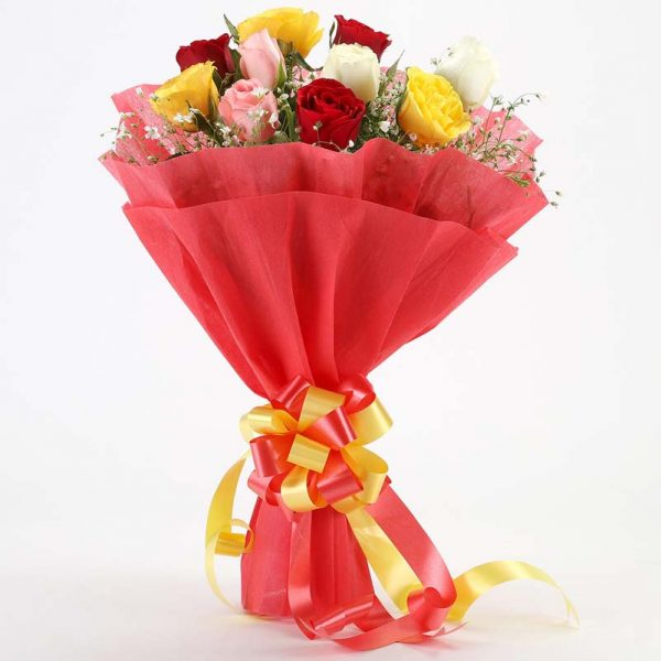 10 mixed colored roses with green leaves wrapped in red paper and tied with yellow ribbon