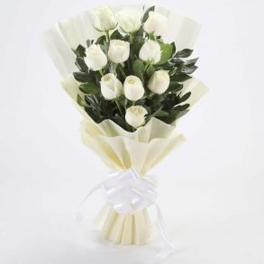 10 white roses with green leaves wrapped in white paper and tied with white ribbon