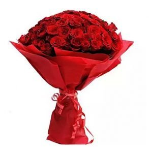 100 red roses wrapped in red paper and tied with red ribbon