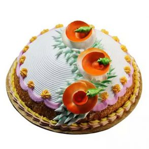 Round shaped designer butter scotch cake decorated with orange cream flower