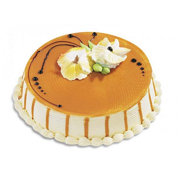 Round shaped coffee flavoured cake decorated with orange sugar syrup