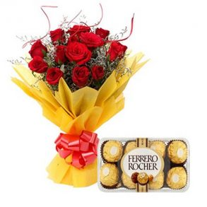 Red roses wrapped with yellow paper and tied with red ribbon, and ferrero rocher chocolates