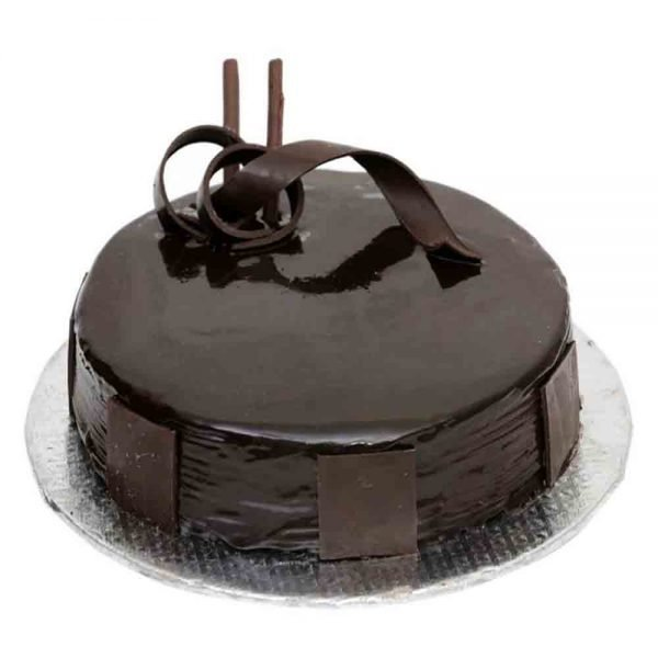 Round shaped chocolate cake with chocolates on top and side