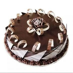 Round shaped chocolate cake decorated with chocolate sticks