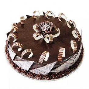 Round shaped chocolate cake decorated with chocolate sticks