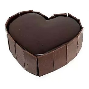 Heart shaped dark chocolate cake decorated with chocolate bars on side