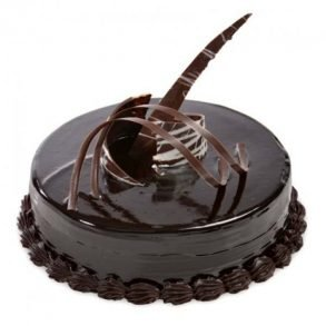 Round shaped chocolate cake with chocolate on top