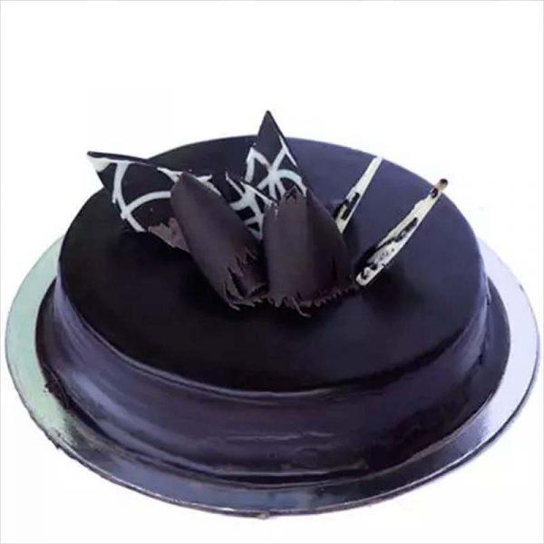 Round shaped chocolate truffle cake decorated with chocolate crust