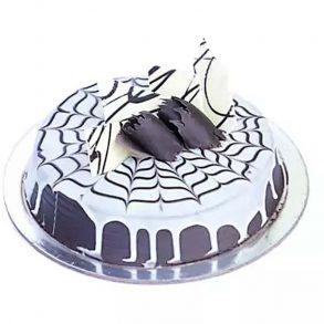 Round shaped chocolate cake decorated with white cream and chocolate