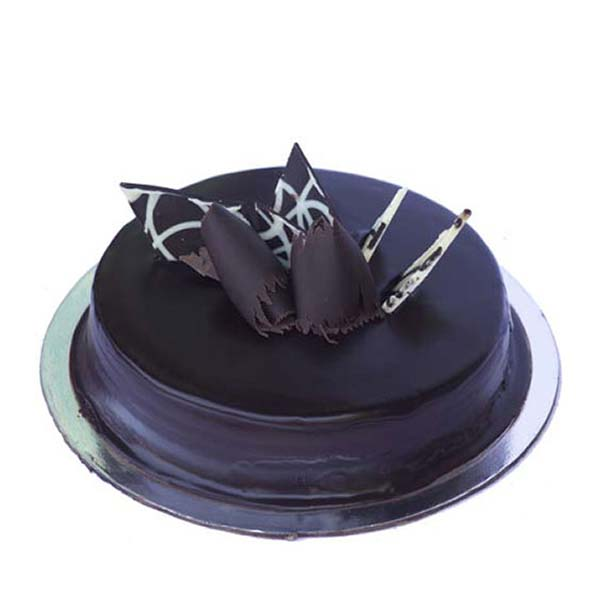 Round shaped chocolate cake with chocolates on top