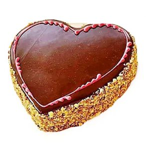 Heart shaped chocolate cake decorated with dry fruits on side