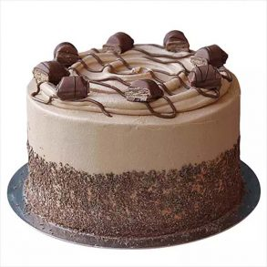 Round shaped coffee cream cake decorated with coffee cream and chocolate pieces