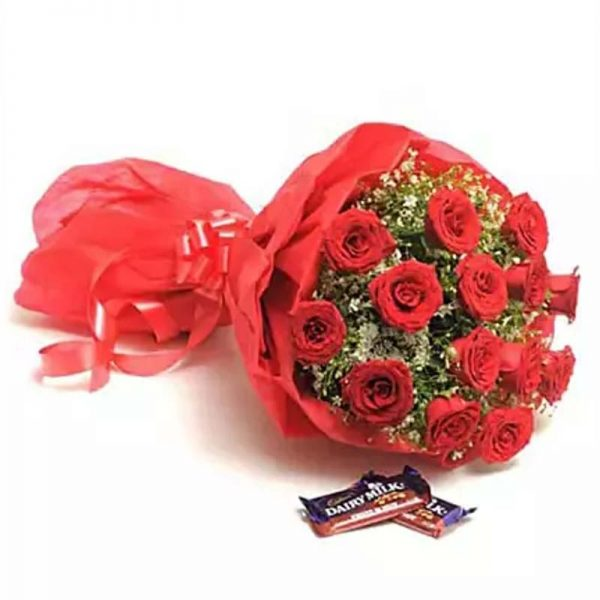 15 Red Roses wrapped in red paper and tied with red riboon and two dairy milk chocolates