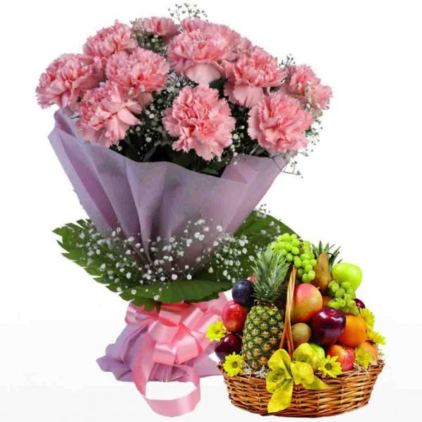 Pink carnations wrapped in pink paper, and fruit basket