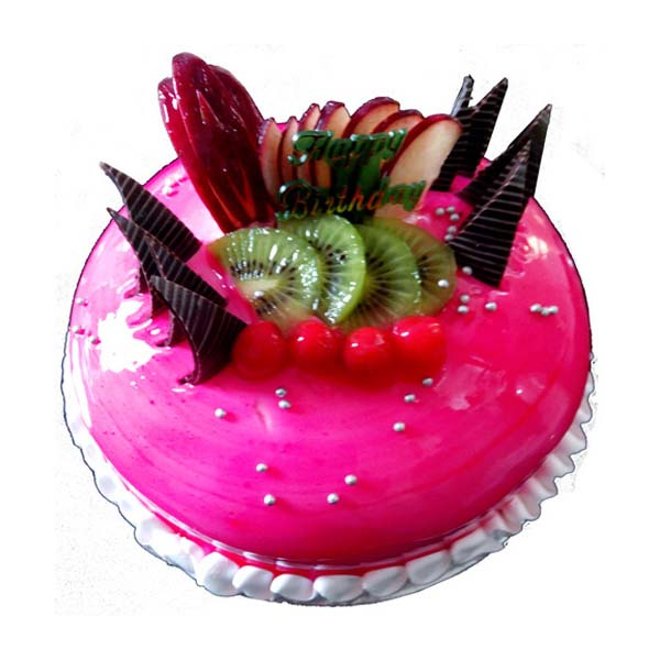 Round shaped pink coloured strawberry cake decorated with fruit slices
