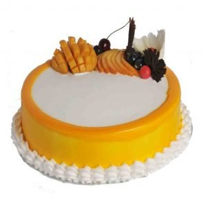 Round shaped mango cake with mango pieces on top