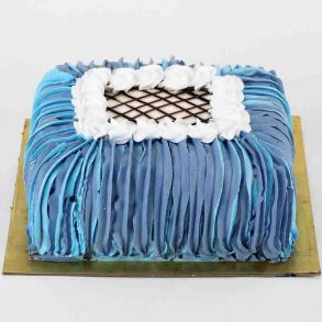 Designer square shaped pineapple cake decorated with blue cream on side and white cream on top