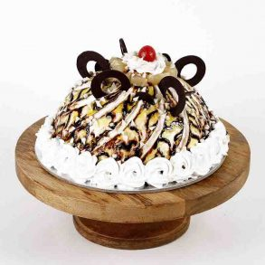 Designer dome shaped pineapple cake decorated with pineapple, cherry and chocolate rings