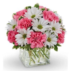 White daisies and pink carnations in a square glass vase
