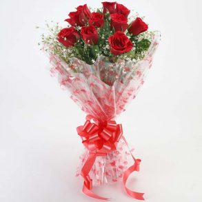 10 red roses with green leaves wrapped in cellophane and tied with red ribbon